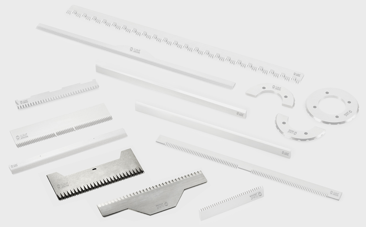 Zig zag blades for vertical packaging machines